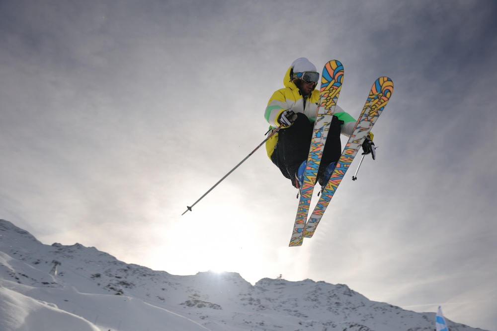 extreme freestyle ski jump with young man at mountain in snow park at winter season-1