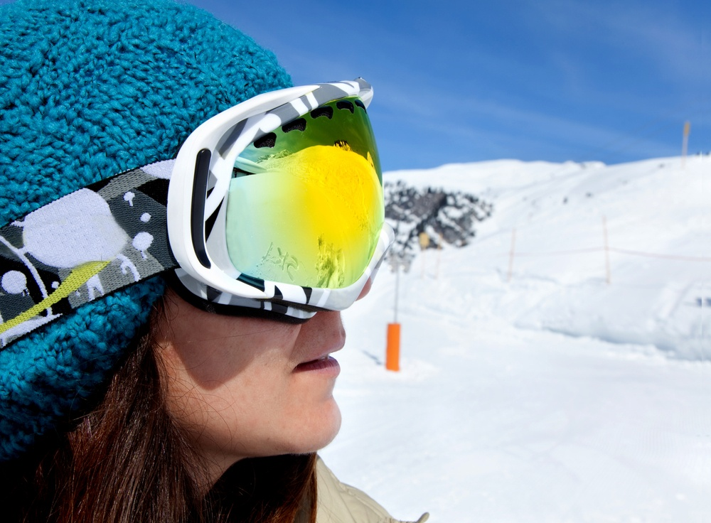 female skier wearing ski glasses at the ski piste